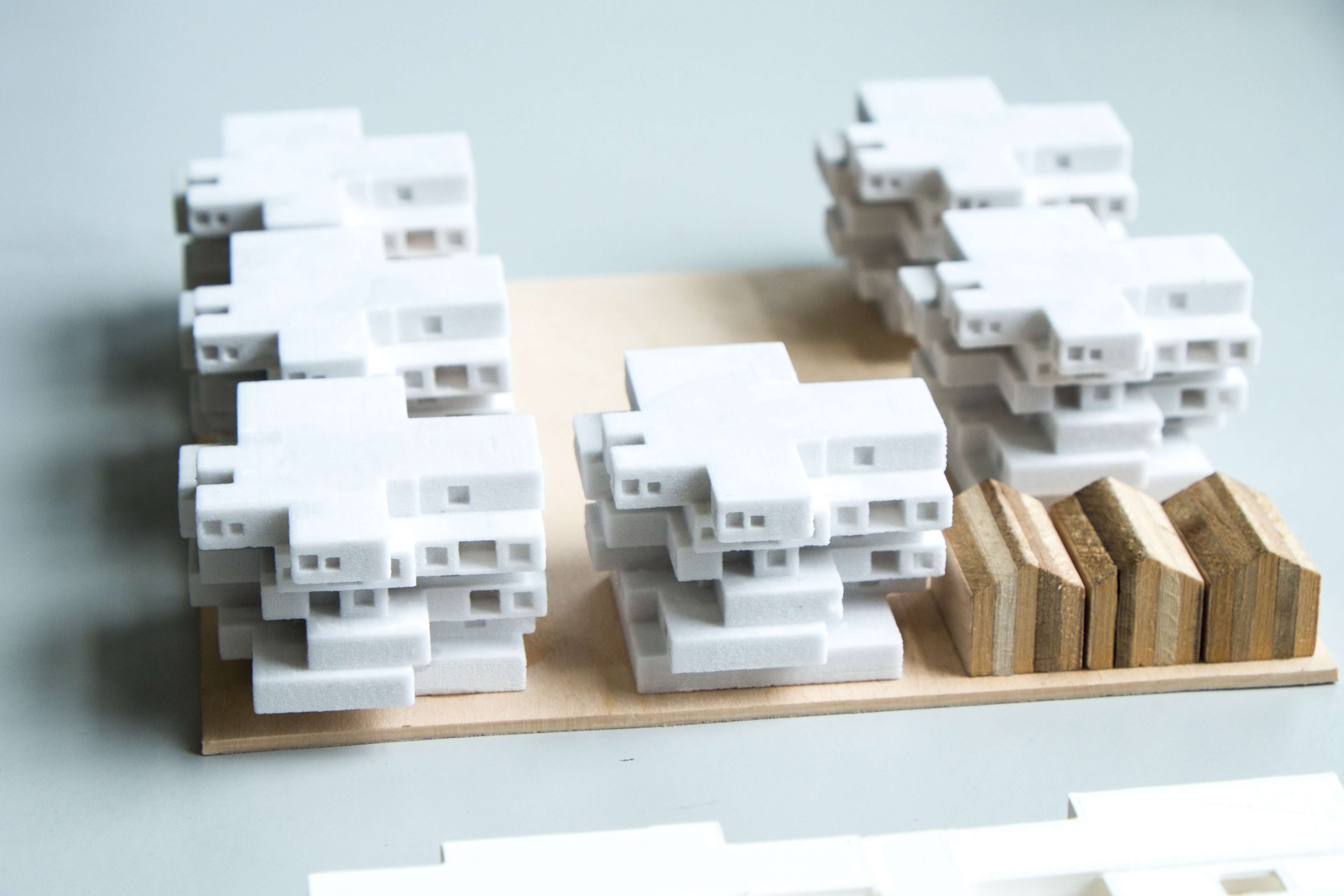 architectural model with 3D printed buildings on a wood base