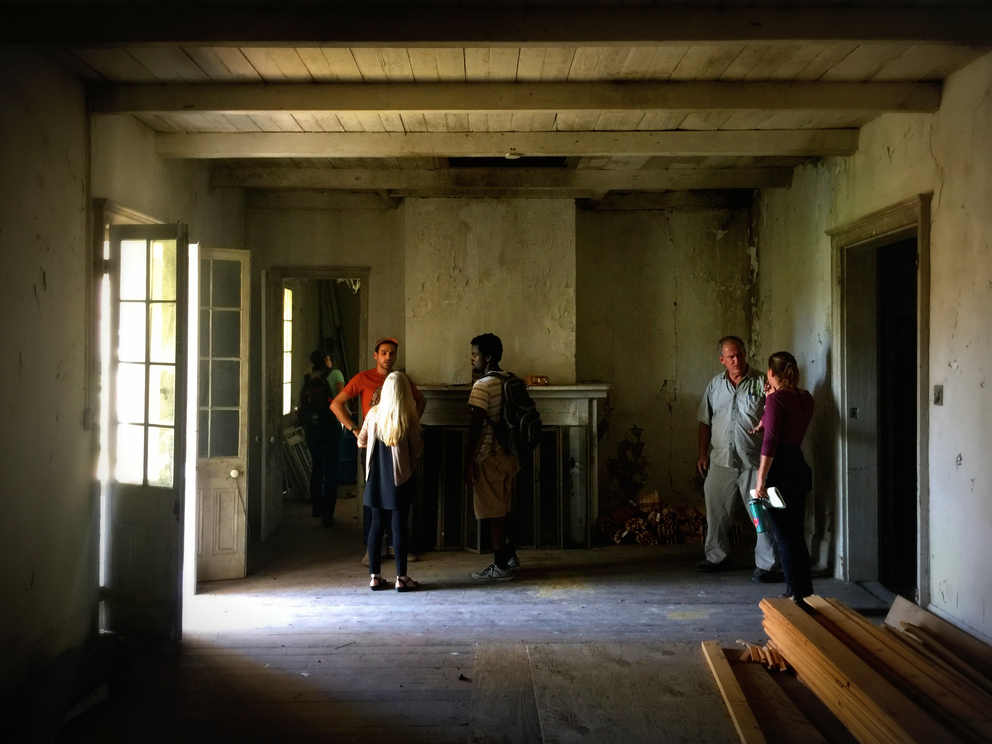 students in dimly lit room of historic structure at Camp Salmen