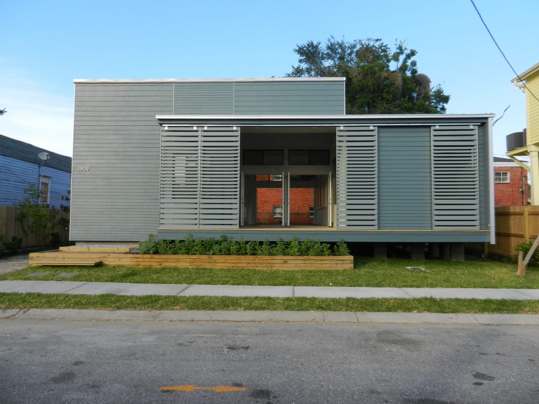 Front view of modern single-story home on an empty street.