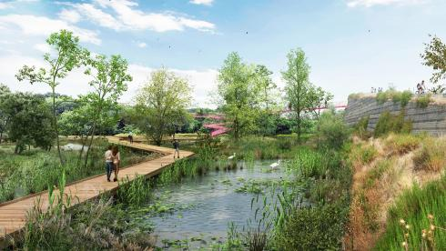 Digital perspective rendering of people walking on a elevated walking path through a watery marsh area with a bridge to a stone cliff in the background
